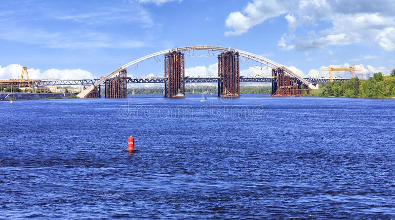 Construction Podolsky bridge on the Dnipro River in Kyiv royalty free stock image