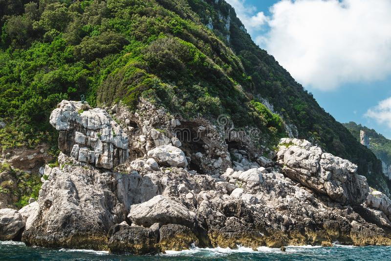 View from the boat on Capri island coast. Italy stock photo