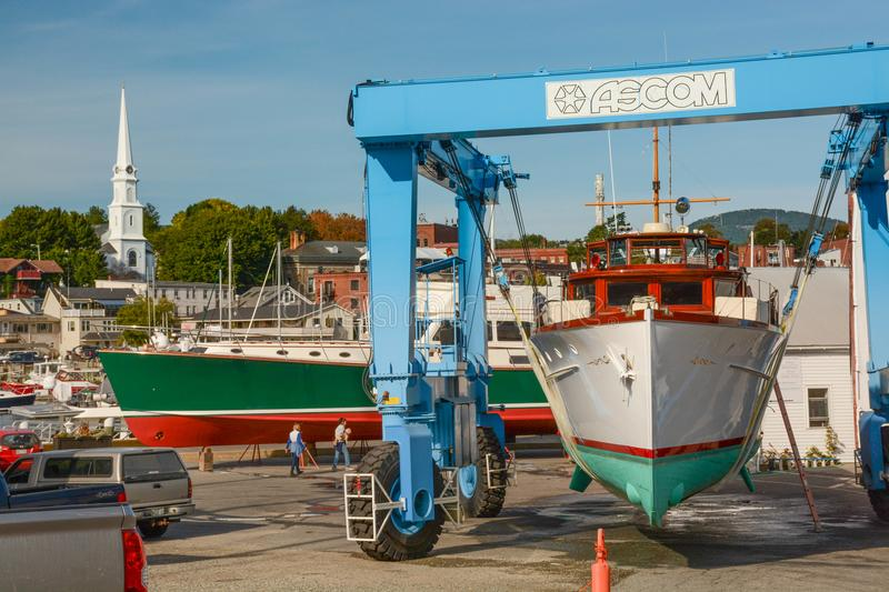Boat in a Sling in Camden, Maine royalty free stock photo