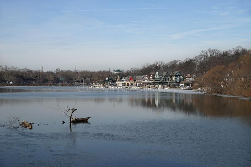 View of boathouse row, Philadelphia in winter. View of boathouse row with snag sticking out from the water at the foreground, Philadelphia in winter stock photos