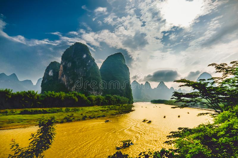 Boats on Li River in Yangshuo China surrounded by Karst Mountains. View on Boats on Li River in Yangshuo China surrounded by Karst Mountains stock photos