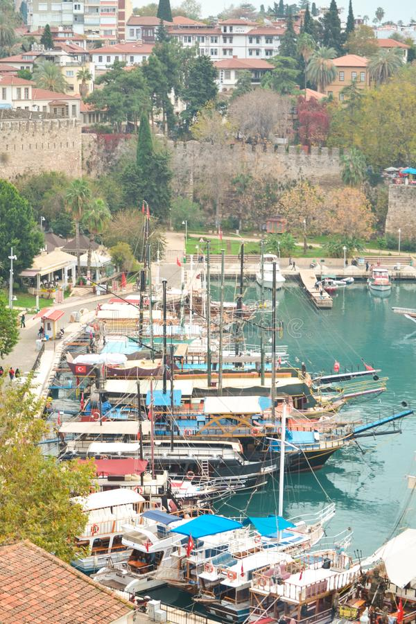 View of the boats standing in the harbor. Old town Kaleici in Antalya, Turkey - travel background. Top view of the roofs of houses stock image