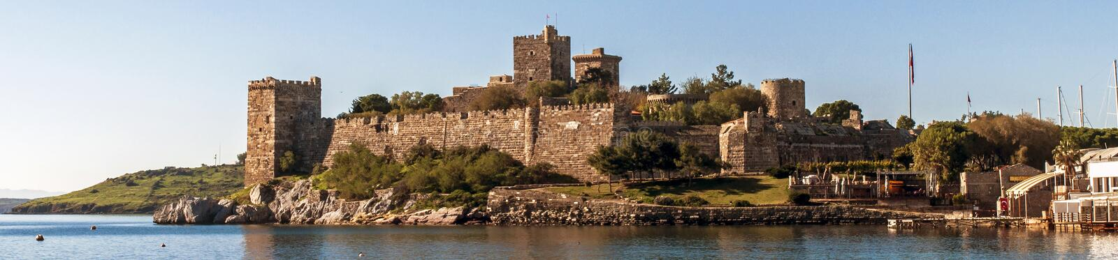 Bodrum Castle. A view of Bodrum Castle and a rocky coast in front of it, Bodrum, Mugla, Turkey royalty free stock photos