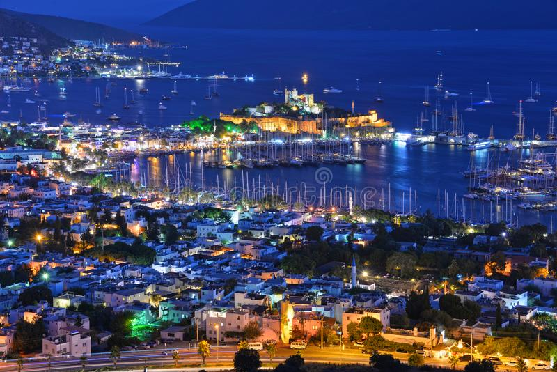 View of Bodrum harbor and Castle of St. Peter by night. Turkish Riviera stock images