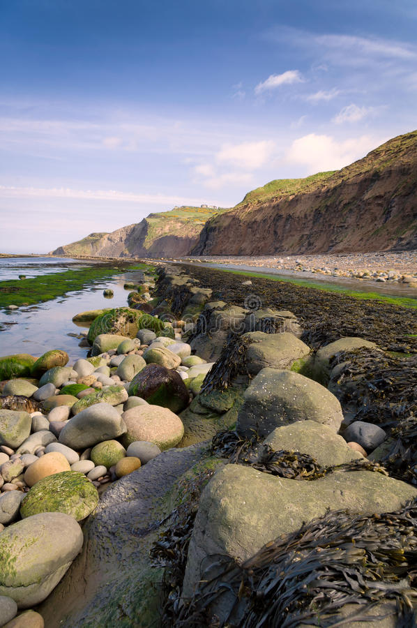 A view from Boggle Hole. Boggle hole near Robin Hoods Bay, North Yorkshire, UK royalty free stock photography