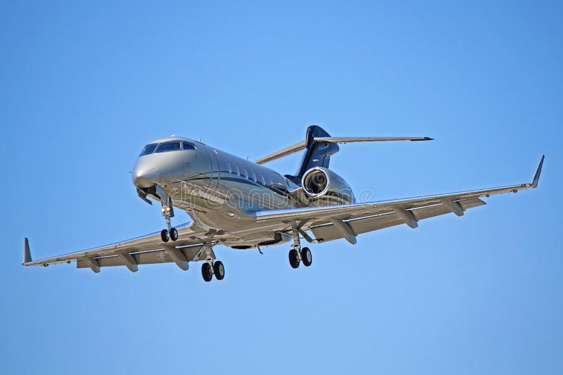 Bombardier Challenger 300 On Final Approach. View of a Bombardier Challenger 300 business jet. A popular corporate jet, the Challenger 300 can seat up to nine stock photos