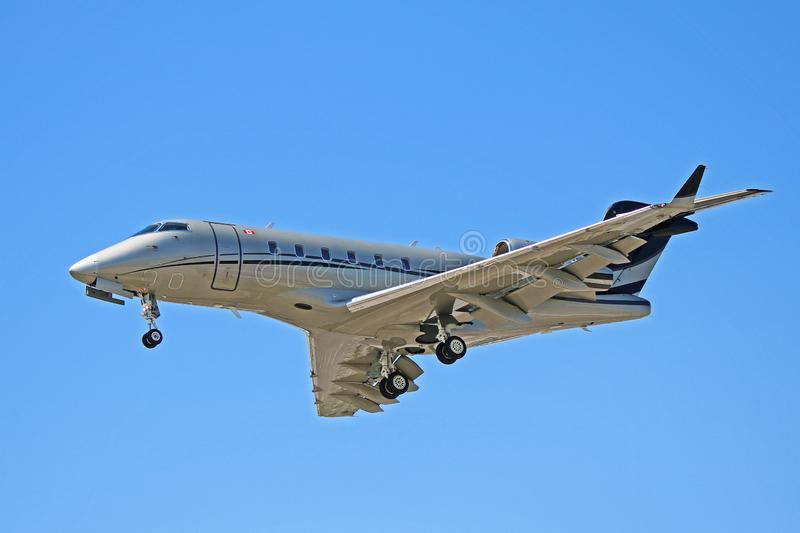 Bombardier Challenger 300 Side View. View of a Bombardier Challenger 300 business jet. A popular corporate jet, the Challenger 300 can seat up to nine passengers stock image