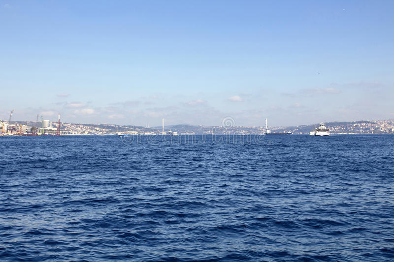 View of Bosphorus from public ferry. Ships, boats and bridge and blue sea are in the view royalty free stock image