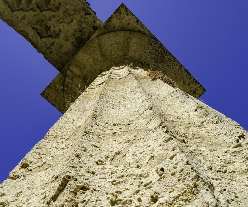 View from the bottom of a column of a Greek temple. In the archaeological park of Paestum, Salerno - Italy stock photography