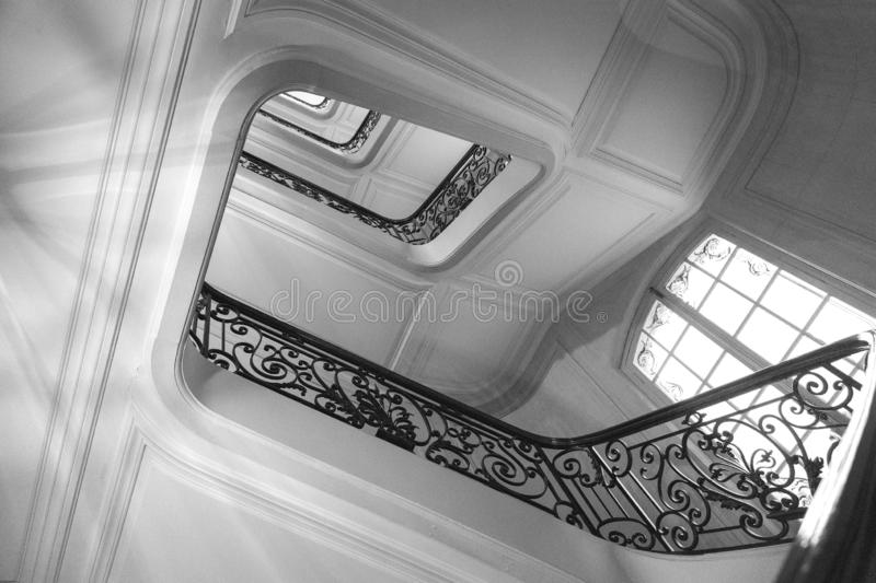 View bottom up on beautiful luxury staircase with wooden railings stock photography