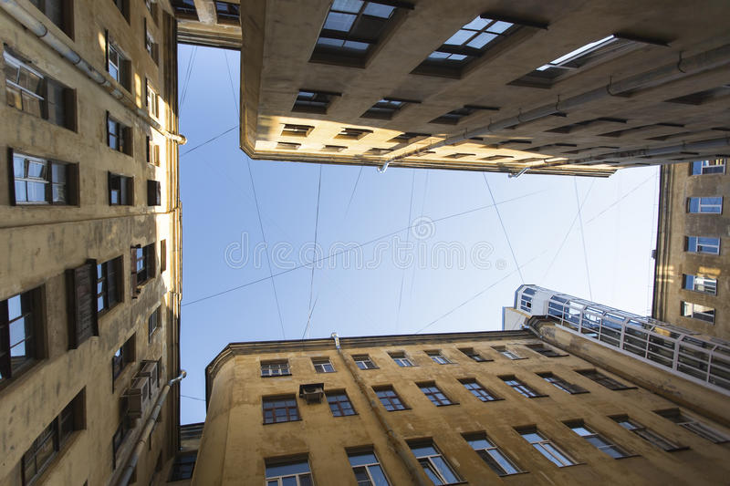 View from the bottom up in court yard-wells in the historic center of St. Petersburg, Russia. Travel. View from the bottom up in court yard-wells in the royalty free stock photos