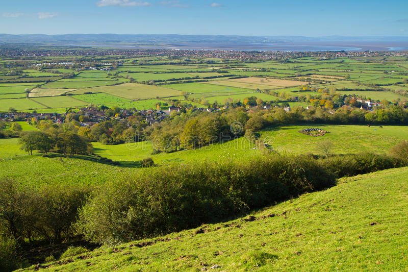 View from Brent Knoll Somerset to Quantock Hills. Brent Knoll hill on the Somerset Levels in Somerset, England. It is located half way between Weston-super-Mare stock image