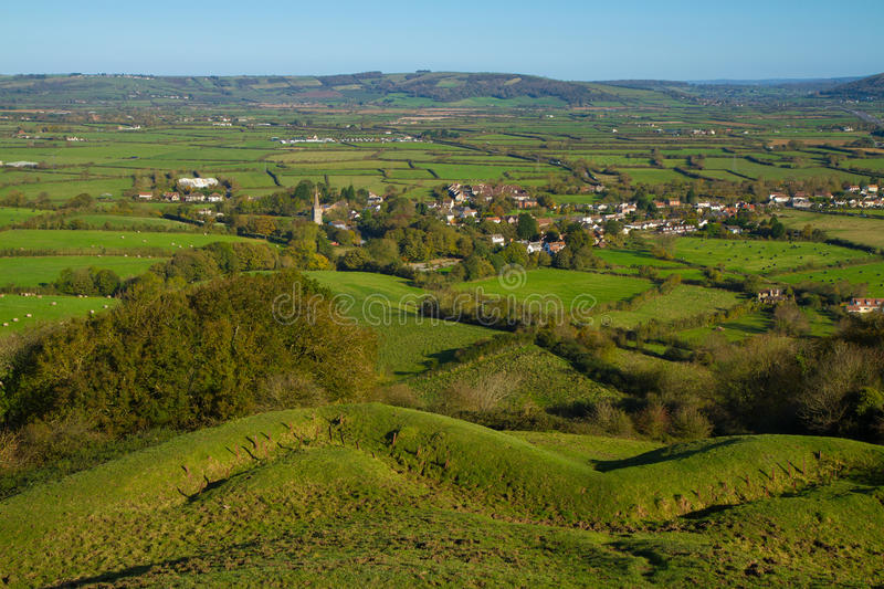 View from Brent Knoll towards Mendip Hills. Brent Knoll hill on the Somerset Levels in Somerset, England. It is located half way between Weston-super-Mare and royalty free stock photo