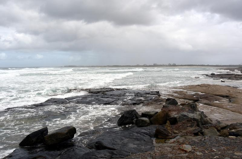 View of Bribie sandy Island from Kings beach. On a stormy cloudy day Caloundra, Sunshine Coast, Queensland, Australia royalty free stock photos