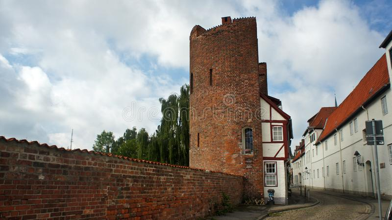 View of the brick wall and Halbturm-Haus, a half-timbered house at the street An der Mauer, beautiful architecture, Lubeck, stock image