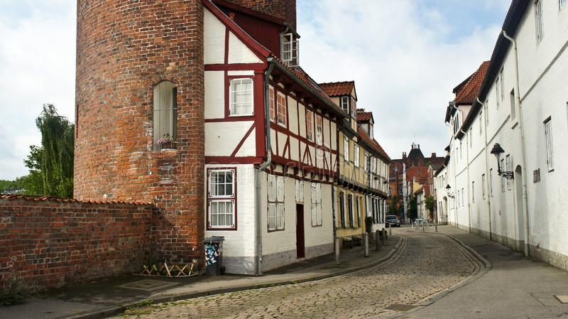 View of the brick wall and part of Halbturm-Haus, a half-timbered house at the street An der Mauer, beautiful architecture, Lubeck stock photography