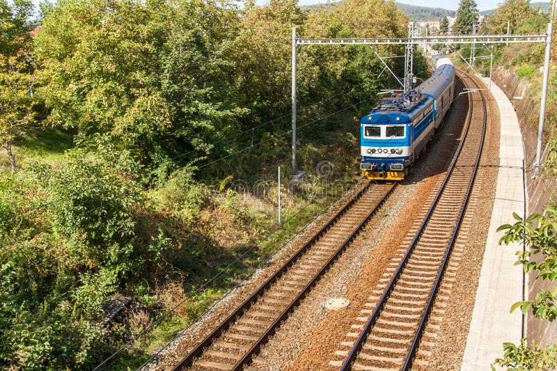 View from the bridge on a moving passenger train on the Tisnov - Brno line in the Czech Republic. Rail transport. Ecological stock photos