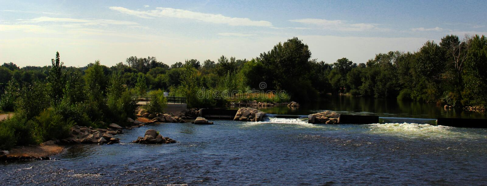 Looking Over the Boise River. A view from a bridge over the Boise River in Boise, Idaho royalty free stock photo