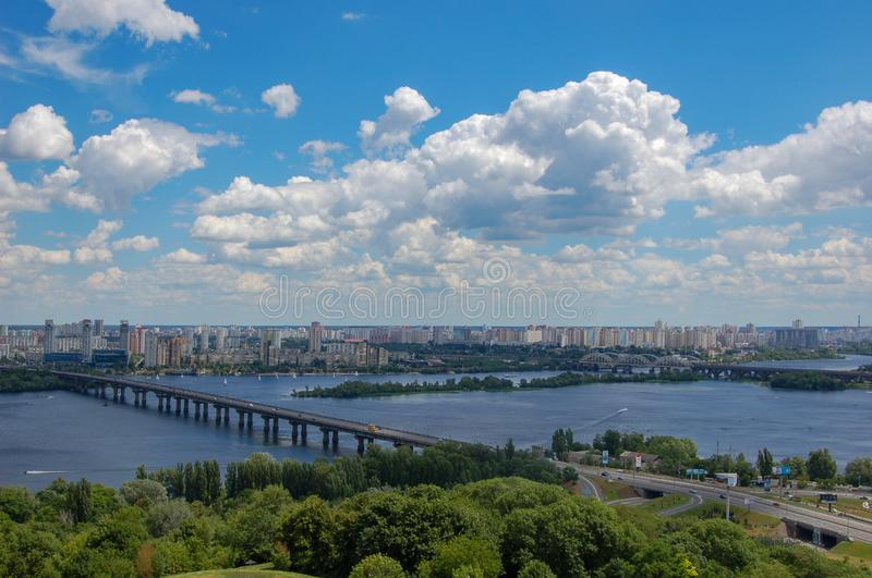View of the bridge over the Dnieper river and the city of Kiev, Ukraine. In summer time royalty free stock image