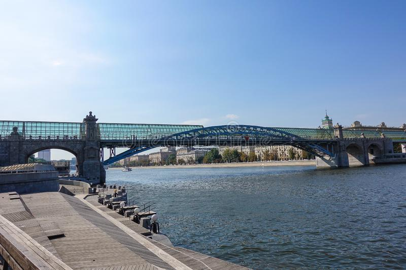 View of the bridge over the Moscow river. Wooden embankment royalty free stock photo