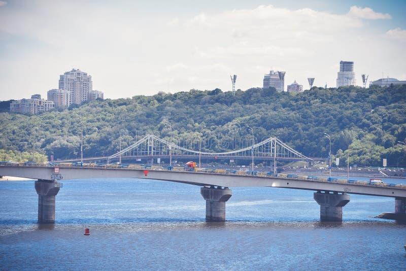 Bridge over river in big city. View of the bridge over the river in Kiev stock photos