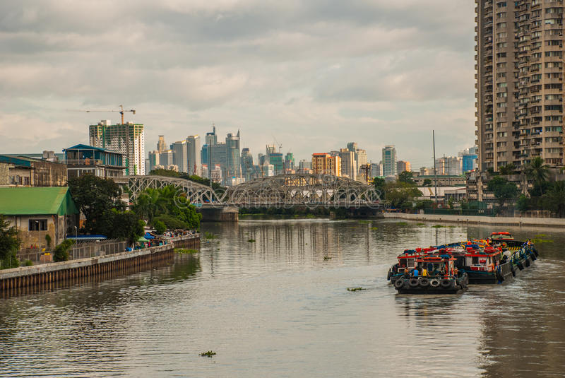 The view from the bridge over the river and skyscrapers. Manila, Philippines. royalty free stock photos