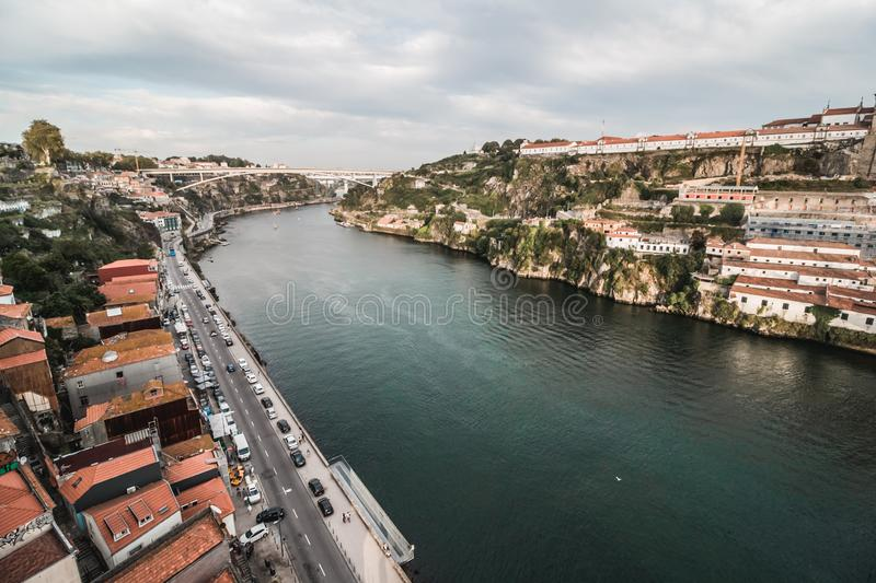 view at bridge Ponte do Infante on Douro river in Porto. Landscape with river and Vila Nova de Gaia city on the hilly shore royalty free stock photo