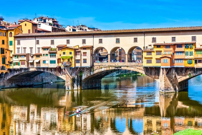 Ponte Vecchio and Kayak. A view of the bridge ponte vecchio across the arno river in florence italy royalty free stock photos