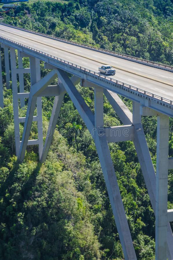 View of the bridge Puente de Bacunayagua with typical Cuban vintage car. Crop with Tele royalty free stock photo