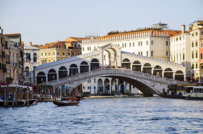 View of Bridge Rialto on Grand canal and gondola boat, Venice, Italy royalty free stock photo