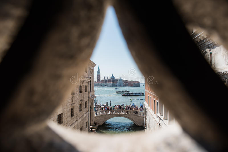 View Bridge in Venice from another bridge. View of a bridge from anther bridge in venice, towards the main canal showcasing architecture and boats passing by stock photos