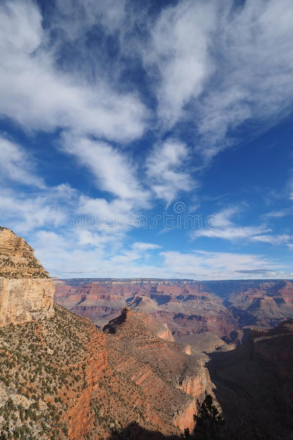 View from the Bright Angel Trail in the Grand Canyon in winter. Winter canyon view under a brilliant cloudscape from the Bright Angel Trail in Grand Canyon stock image