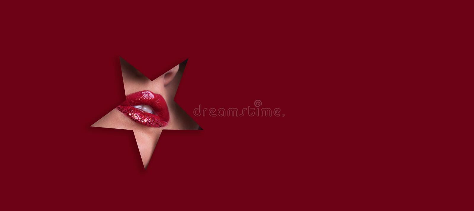 View of bright lips with glitter through hole in paper background. Make up artist, beauty concept. Ready to new year party. stock image
