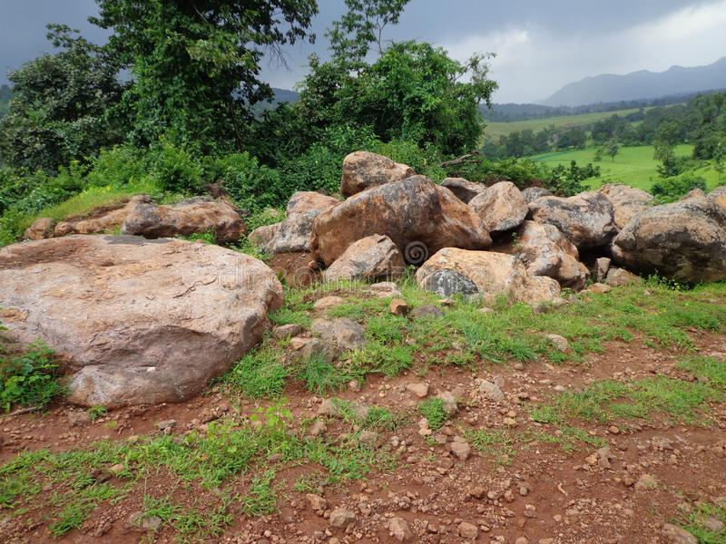 View of broken big stone pieces from rocks stock photo