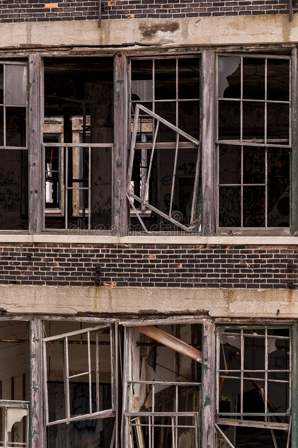 Broken Windows - Abandoned Packard Automobile Factory - Detroit, Michigan royalty free stock image