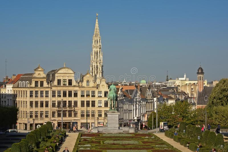View on Brussels from,`Mont des arts` park with historical houses and the spire of the city hall royalty free stock photos