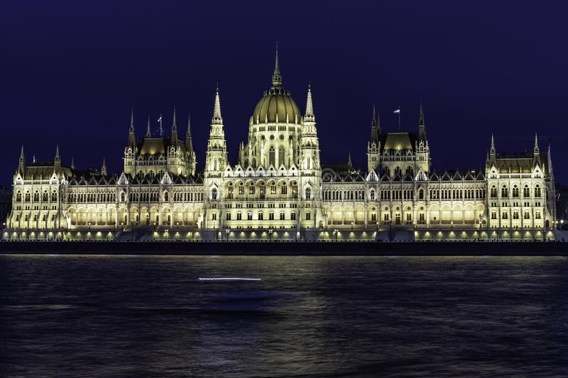 View of Budapest Parliament at dusk with its roofs at blue hour, Hungary. View of the Parliament of Budapest at dusk with its roofs, its illuminated facade and royalty free stock photography