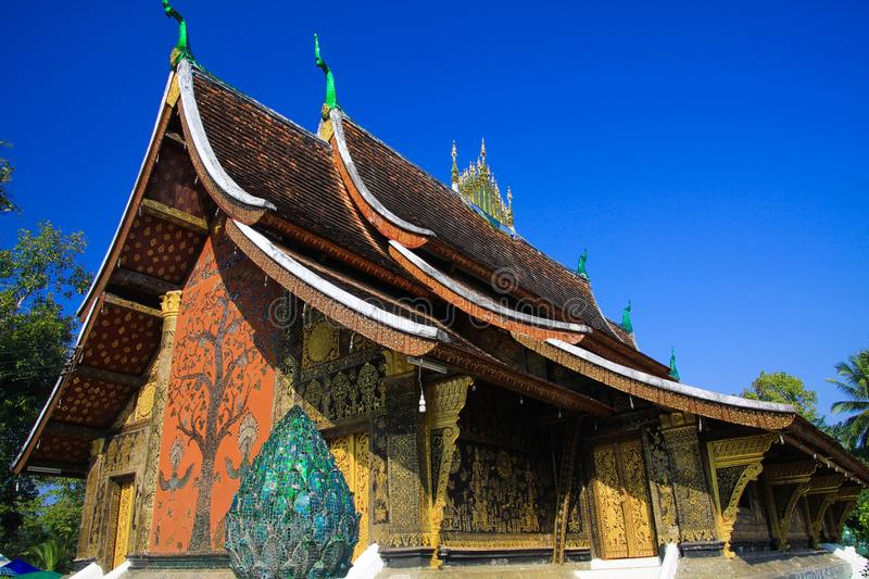 View on buddhist temple against blue sky - Wat Xieng Thong, Luang Prabang royalty free stock photo