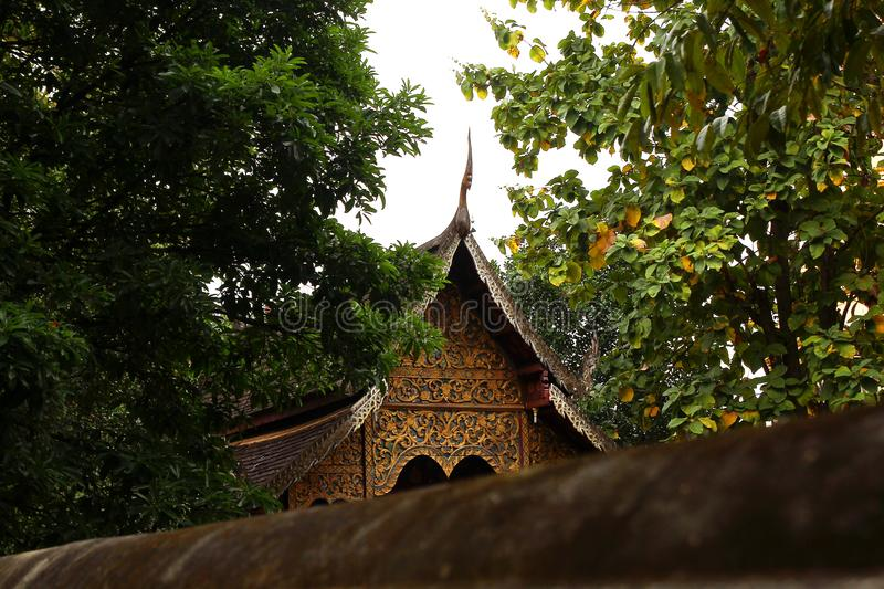 View on a Buddhist temple between trees. Chiang Mai, Thailand stock photos