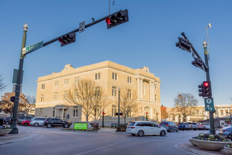 View of a building on a corner captured in McKinney, Texas, United States. MCKINNEY, TEXAS, UNITED STATES - Dec 28, 2018: A view of a building on a corner stock photography
