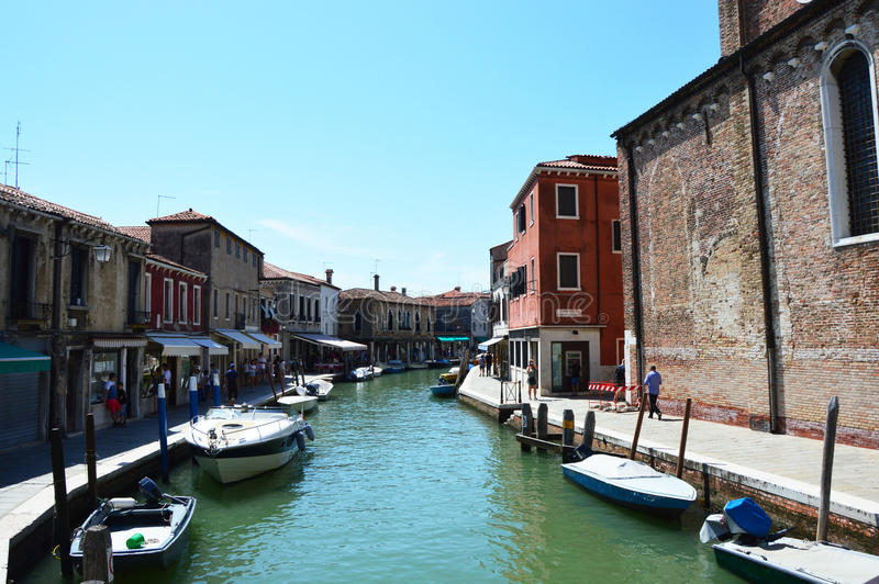 View of buildings and canal with tourists and boats in Murano, a nice little town on top of islands near Venice, Italy stock photos
