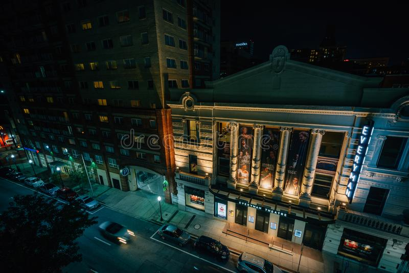 A view of buildings on Fayette Street at night, in downtown  Baltimore, Maryland.  stock photo