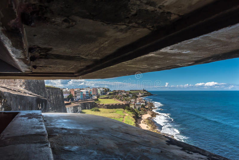 View from a bunker within Castillo de San Cristobal. Along the ocean toward San Felipe del Morro stock photos