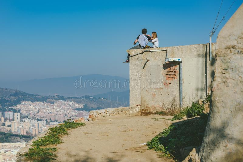 View from Bunkers del Carmel panorama, Barcelona. BARCELONA, SPAIN - DECEMBER 26, 2015: People watching panorama of Barcelona form the hill known as the `Turo de stock images