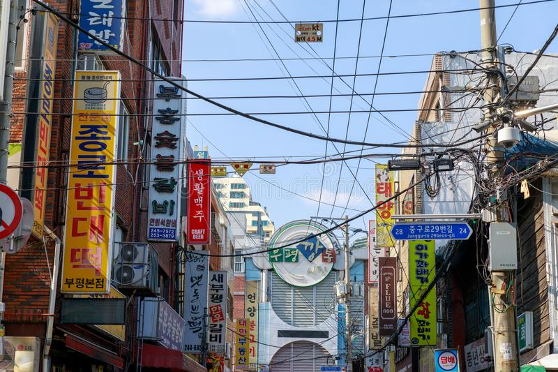 View of Bupyeong Kkangtong Market with various restaurant signages in Busan city royalty free stock photos