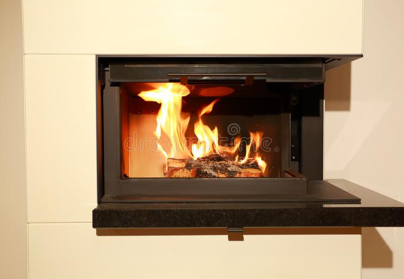 View of burning wood in fire place royalty free stock photo