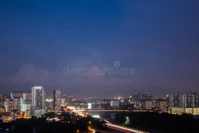 View of business district in Shah Alam with major highway during blue hour stock photography