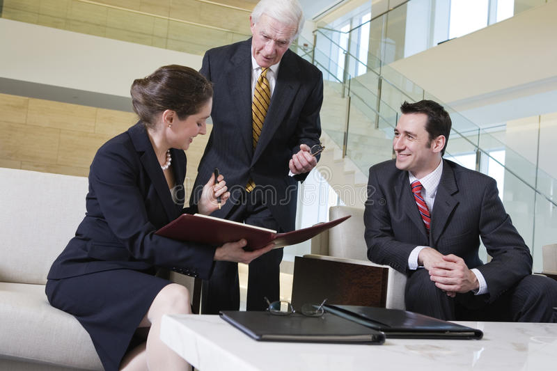 View of business team meeting in office lobby. stock photos