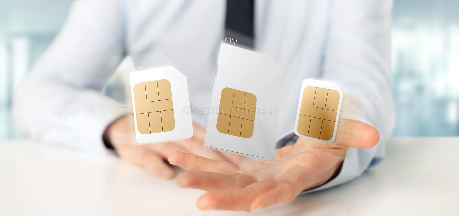 Businessman holding Different size of a smartphone sim card 3d r stock photo