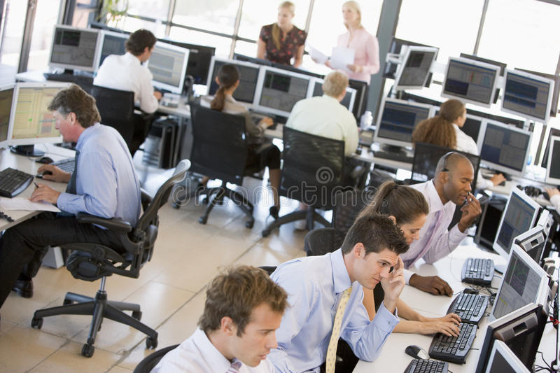 View Of Busy Stock Traders Office. With Traders Concentrating stock photos